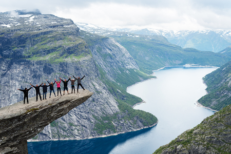 Foto de Norway, Odda, rock formation Trolltunga, July 18, 2017: group of tourists photographed on a rock - Imagen libre de derechos