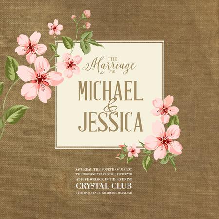 Wedding invitation on fabric background. Spring flowers. Cherry blossom.