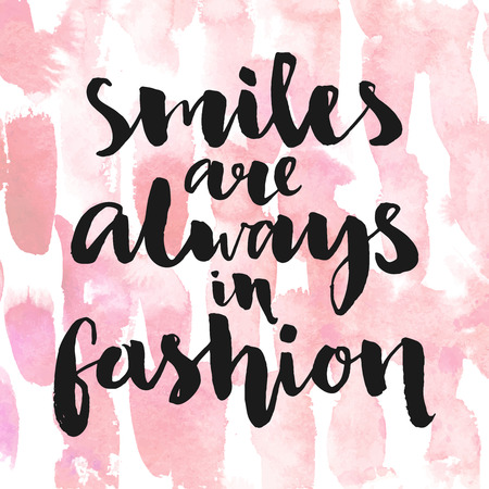 Illustration pour Smiles are always in fashion. Inspirational quote handwritten with black ink and brush, custom lettering for posters, t-shirts and cards. Vector calligraphy on pink watercolor strokes background. - image libre de droit