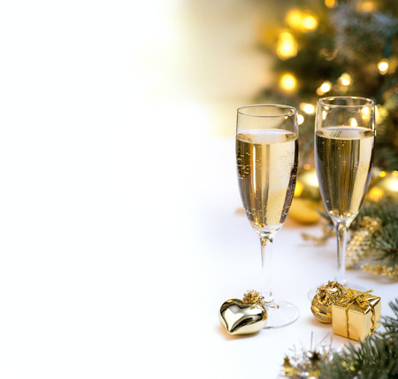 Photo pour Glasses with champagne glasses for new year celebration - image libre de droit