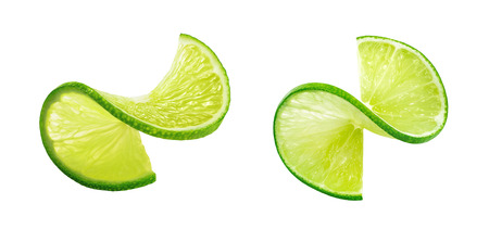 Foto de Fresh lIme slice twist isolated on white background as package design element - Imagen libre de derechos