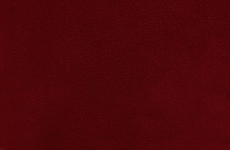Closeup detail of red  maroon leather texture background