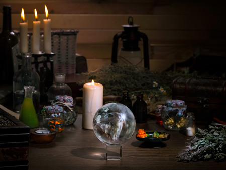 Foto per Mystical still life - the magic ball, candles, herbs. Many magic items and utensils alchemist. Concept - magic, witch board, alternative medicine, occult and witchcraft. Halloween - Immagine Royalty Free