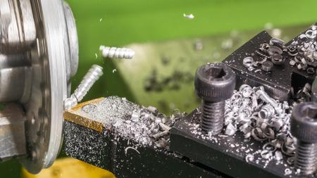Foto de Detail of lathe, tool bit and metal shavings when machining. Screwed swarf in flight during turning of workpiece. Beautiful motion blur. - Imagen libre de derechos