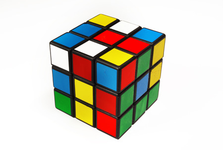 Foto de Colorful and world famous Rubik's cube in a scrambled state on a white background - Imagen libre de derechos