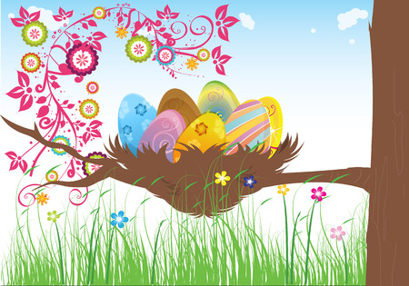 Easter cakes warm spring day the green grass with flowers on a background of blue sky and a tree with a nest on it containing Easter eggs