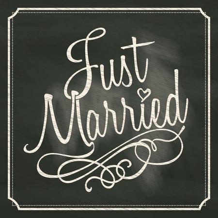 Foto de Just Married lettering sign on chalkboard background  - Imagen libre de derechos
