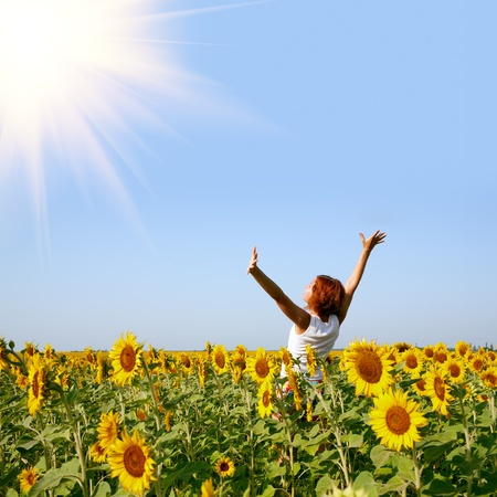 Photo for beauty redhaired woman in sunflower field - Royalty Free Image