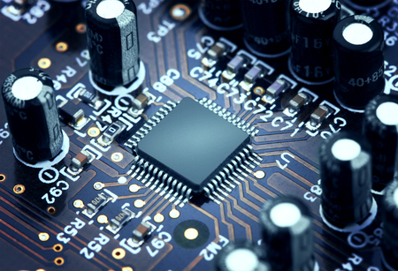 Foto de Electronic circuit board with processor, close up. - Imagen libre de derechos