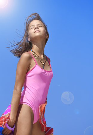 Photo pour Beautiful girl with scarf on the beach. Travel and leisure. The concept of freedom - image libre de droit