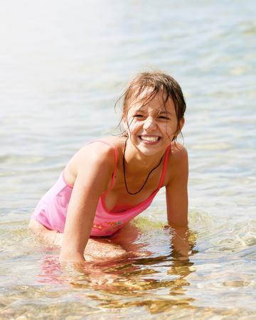 Beauty Sunshine Girl Portrait. Pretty happy woman enjoying summer outdoors. Sunny Summer Day under the Hot Sun on the Beach.