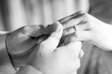 Photo pour Young married couple holding hands, Black and White Image - image libre de droit