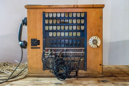 Photo pour Antique wooden historical telephone exchange - image libre de droit