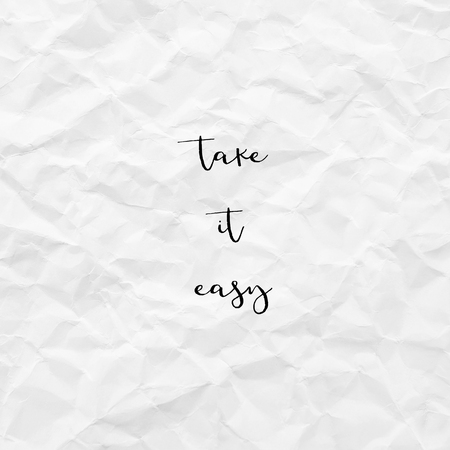 Photo pour Take it easy. Inspirational quote on white crumpled paper. - image libre de droit