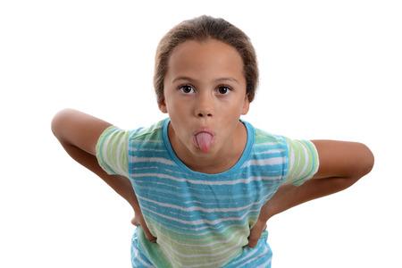 Foto de little girl sticking out tongue white background - Imagen libre de derechos