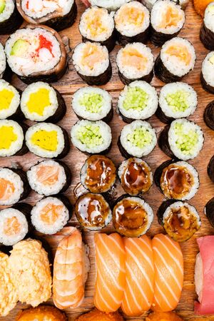 Photo pour top view of big set of sushi and rolls on wooden table - image libre de droit