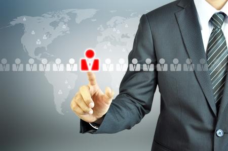 Photo pour Businessman pointing human sign - HR,HRM,HRD ,CRM concept - image libre de droit