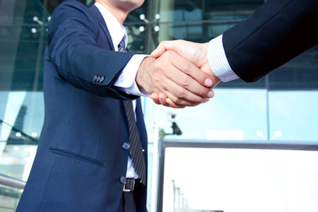 Photo for Handshake of businessmen - success, congratulation, greeting & business partner concepts - Royalty Free Image