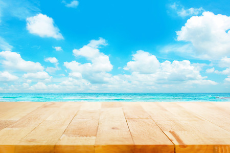 Foto de Wood table top on blue sea & sky background can put or montage your products for display - beach & summer concepts - Imagen libre de derechos