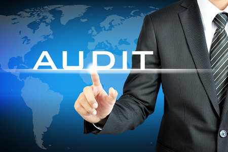 Photo for Businessman touching AUDIT sign on virtual screen - Royalty Free Image