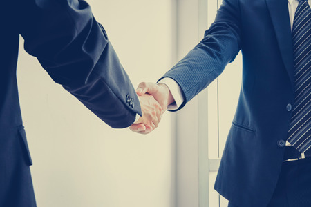 Photo for Handshake of businessmen; success, dealing & business partner concepts - vintage color effect with soft focus - Royalty Free Image