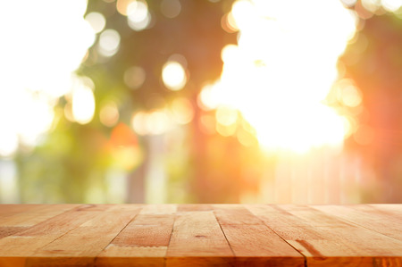 Photo pour Wood table top on shiny sunlight bokeh background - can used for display or montage your products - image libre de droit
