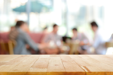 Photo pour Wood table top with blurred people in cafe as background - can be used for montage or display your products - image libre de droit
