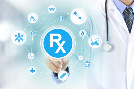 Photo pour Doctor hand touching Rx sign on virtual screen - image libre de droit