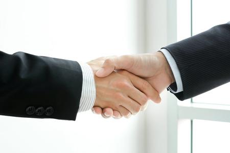 Foto de Handshake of businessmen -  greeting,dealing & partnership concepts - Imagen libre de derechos