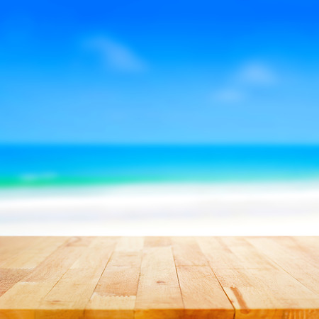 Photo for Wood table top on blurred beach background, summer concept  - can be used for display or montage your products - Royalty Free Image