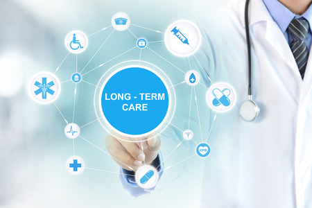 Photo pour Doctor hand touching LONG TERM CARE sign on virtual screen - image libre de droit