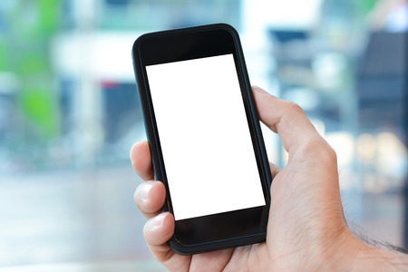 Foto de Hand holding smart phone  with empty screen - Imagen libre de derechos