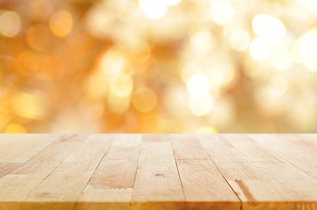Photo pour Wood table top on shiny bokeh gold background - can be used for display or montage your products - image libre de droit