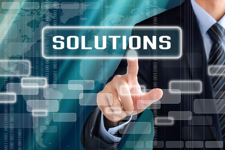 Businessman hand touching SOLUTIONS sign on virtual screen