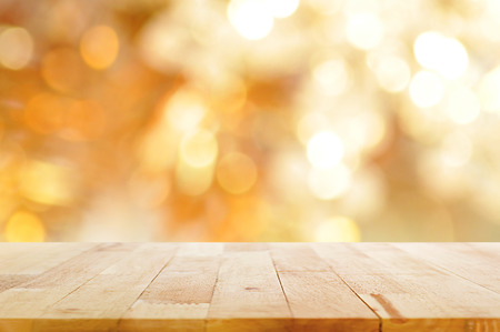 Photo pour Wood table top on blur bokeh golden background - can be used for display and montage your products - image libre de droit