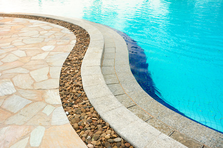 Curved swimming pool coping, made of stones