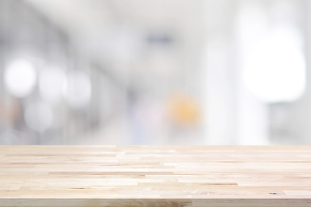 Foto de Wood table top on blurred white gray background from hallway - can be used for display or montage your products - Imagen libre de derechos
