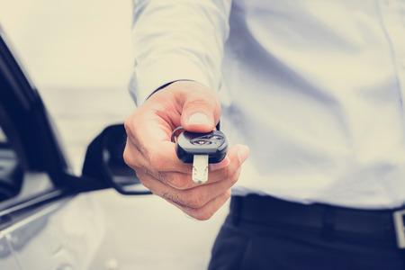 Foto de A man giving car key, vintage tone image - Imagen libre de derechos