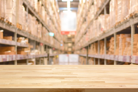 Foto de Empty wood table top on blurred warehouse background - can montage or display your products - Imagen libre de derechos