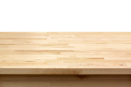 Foto de Wood table top on white background - can montage or display your products on top - Imagen libre de derechos