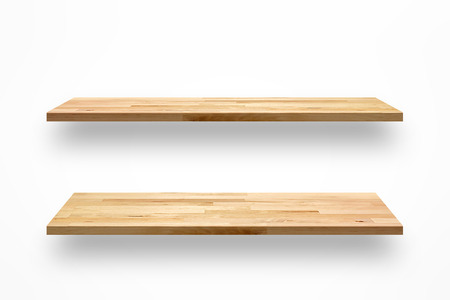 Foto de Empty wooden wall shelves on white background - Imagen libre de derechos