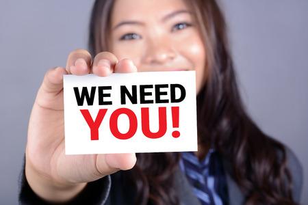 Foto de WE NEED YOU! message on the card shown by a businesswoman - Imagen libre de derechos
