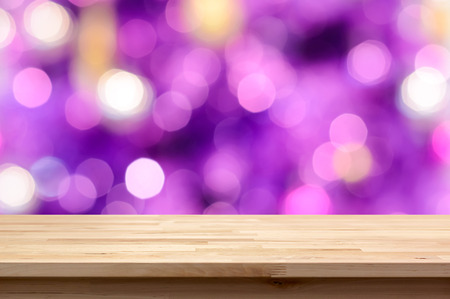 Photo pour Wood table top on colorful purple bokeh abstract background - can be used for montage or display your products - image libre de droit