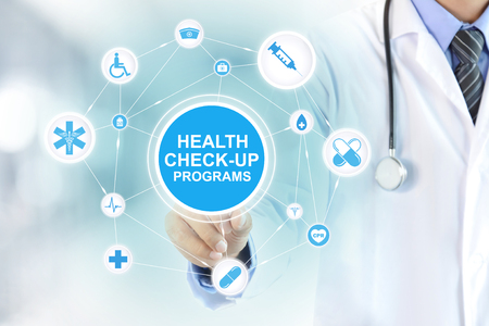 Foto per Doctor hand touching HEALTH CHECK-UP PROGRAMS sign on virtual screen - Immagine Royalty Free