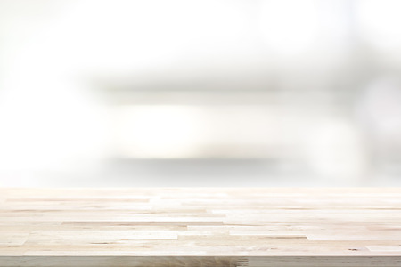 Foto de Wood table top on blur kitchen shelf background - can be used for display or montage your products (or foods) - Imagen libre de derechos