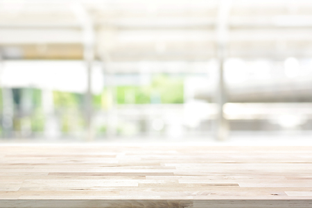 Foto de Wood table top on blur kitchen window background - can be used for display or montage your products (or foods) - Imagen libre de derechos