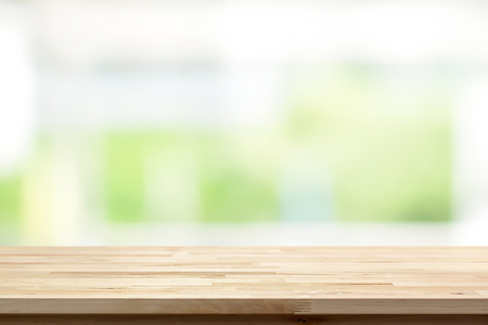 Foto de Wood table top on blur white green kitchen window background - can be used for display or montage your products (or foods) - Imagen libre de derechos