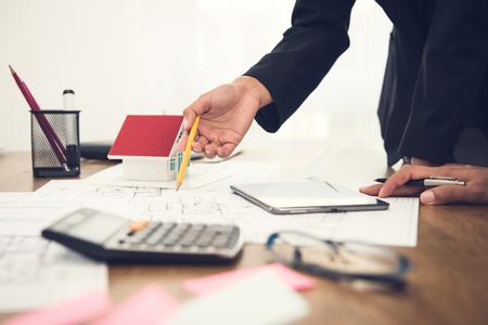 Foto de Real estate agent with client or architect team discussing house floor plan on the table - Imagen libre de derechos