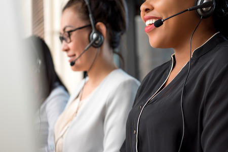 Photo pour Mixed race women team working in call center as telemarketing customer service agents - image libre de droit