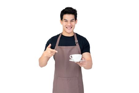 Foto de Service minded handsome smiling Asian barista serving coffee studio shot isolated on white background - Imagen libre de derechos